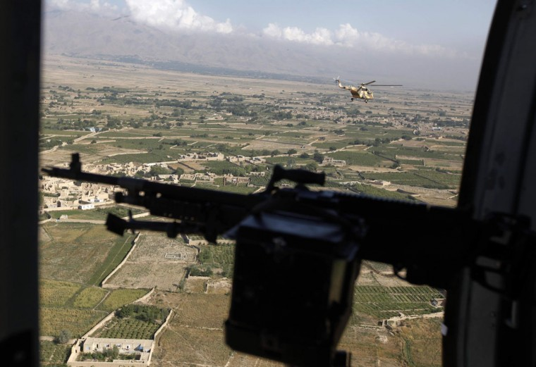 An Afghanistan Air Force helicopter transporting journalists flies near the prison compound before a ceremony handing over the Bagram prison to Afghan authorities, at the U.S. airbase in Bagram, north of Kabul September 10, 2012. (Omar Sobhani/Reuters)