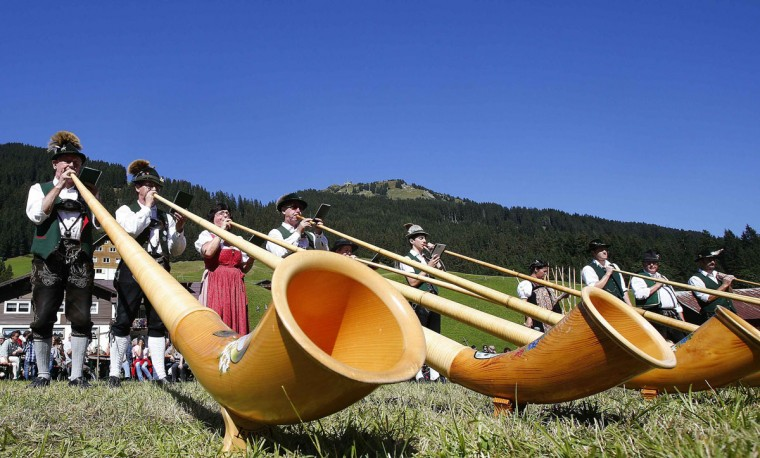 Musicians perform with alphorns during the annual Alphorn Festival in the western Austrian village of Baad, some 124 miles west of Innsbruck September 16, 2012. (Dominic Ebenbichler/Reuters)
