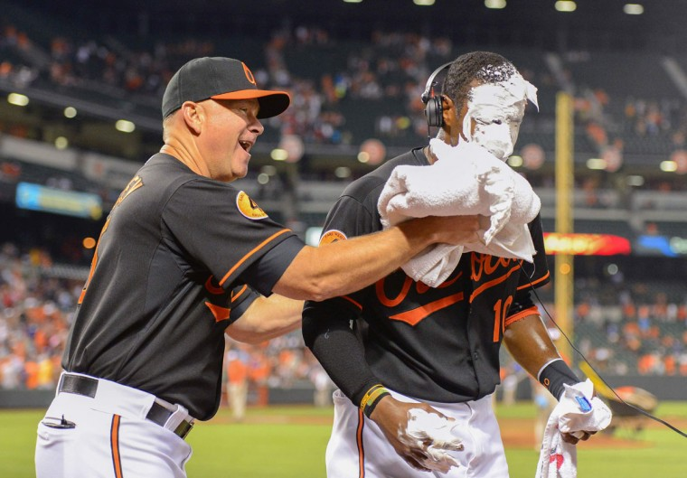 July 2013: Baltimore Orioles center fielder Adam Jones has a pie thrown on him by coach Jim Presley while being interviewed after a game in which he hits two home runs off the Boston Red Sox during their MLB American League baseball game in Baltimore July 26, 2013. (Doug Kapustin, Reuters)