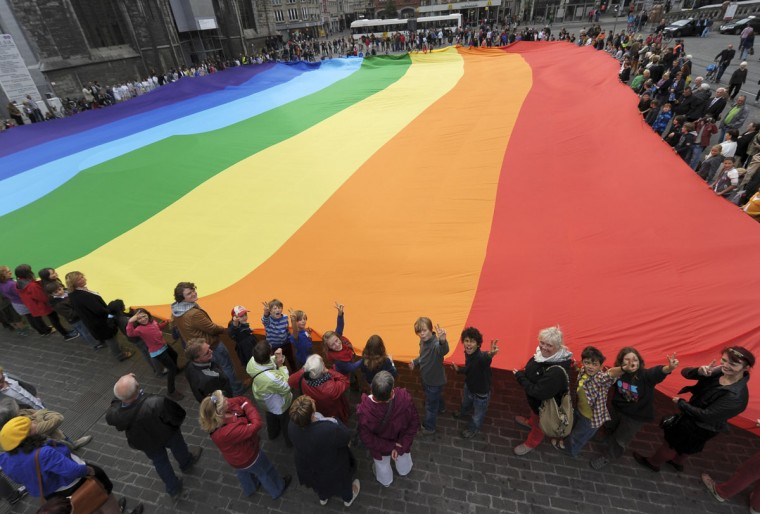 People gather around a peace flag that has set a new world record with its size of 50m (164 ft) by 30m (98.4 ft) during the International Day of Peace in Ghent, Belgium. (Laurent Dubrule/Reuters)