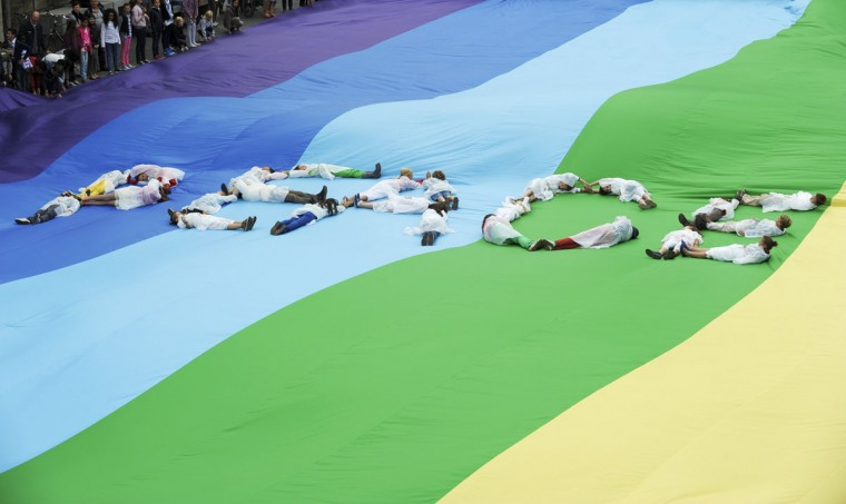 People lie on a peace flag, which has set a new world record with its size of 50m (164 ft) by 30m (98.4 ft), during the International Day of Peace in Ghent, Belgium. (Laurent Dubrule/Reuters)