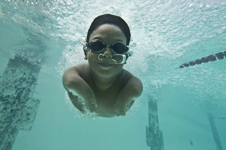 Ten-year-old Lucas Amorim, who has phocomelia, affecting the growth of his arms, swims during a training session in Manaus, Amazonas State, September 19, 2012. Lucas, who was motivated to become a swimmer two years ago by a cousin who is also handicapped and swims competitively, recently won the Amazonas State championship in the S5 category of 50m freestyle for his age group. Apart from his dreams of representing Brazil in a future Paralympics, Lucas wants to be a civil engineer some day. (Bruno Kelly/Reuters)