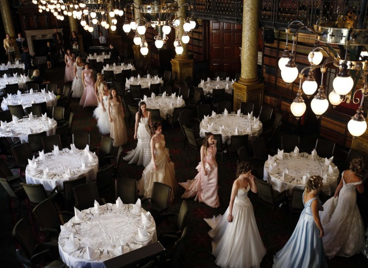 Debutantes rehearse for Queen Charlotte's Ball in central London. Queen Charlotte's Ball is the crowning event of the London Season, a program for a hand-picked group of girls from rich backgrounds, normally between 17 and 20 years old, involving meetings with aristocracy, etiquette classes, and charity fund-raising. (Olivia Harris/Reuters)