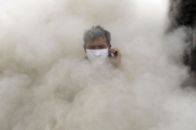 A worker frowns amidst dust inside an open-air plant which crushes rocks to produce construction materials on the Gobi Deserton Gobi Desert in Aksu, Xinjiang Uighur Autonomous Region. China's economic slowdown is expected to reach its nadir this quarter, with a recovery of momentum delayed until the final quarter, leaving growth for 2012 likely to fall below 8 percent, a level unseen since 1999, a Reuters poll showed. (Stringer/Reuters)