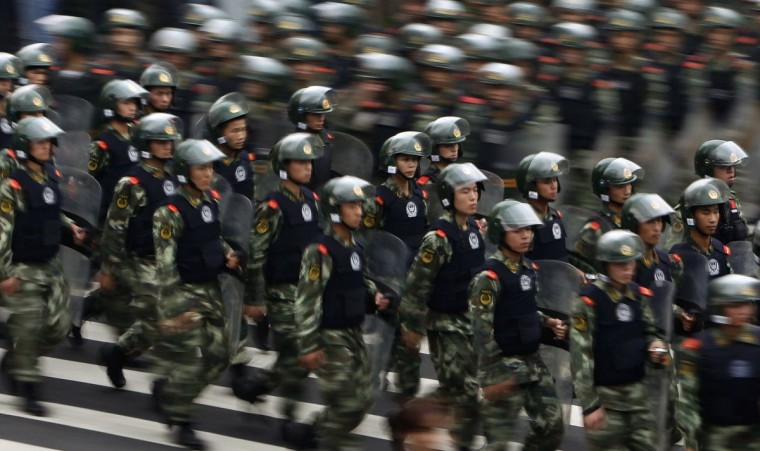 Paramilitary police in riot gear run to their positions to cease a protest on the 81st anniversary of Japan's invasion of China, in Chengdu, Sichuan province. Hundreds of Japanese businesses and the country's embassy suspended services in China on Tuesday, as anti-Japan protests threatened to reignite and drag a territorial dispute between Asia's two biggest economies deeper into crisis. (Jason Lee/Reuters)