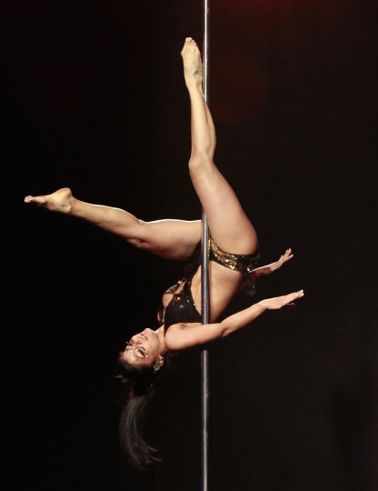 Sara Garsia competes in the annual Colombian pole dancing contest in Medellin September 27, 2012. (Albeiro Lopera/Reuters)