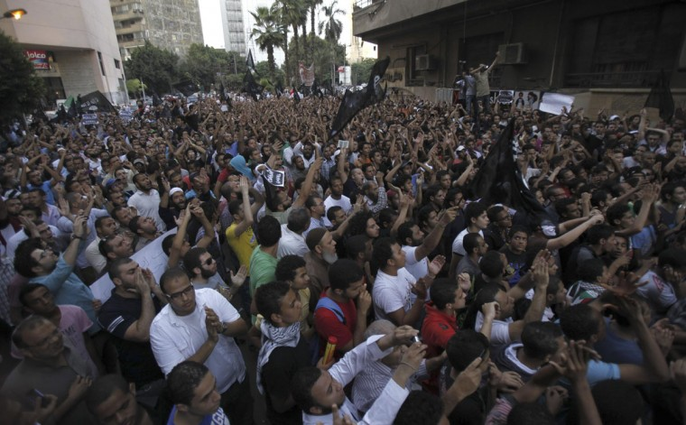 People shout slogans in front of the U.S. embassy during a protest in Cairo September 11, 2012. (Amr Abdallah Dalsh/Reuters)