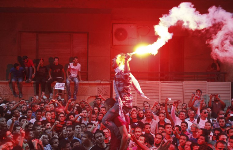 People shout slogans and light flares in front of the U.S. embassy during a protest in Cairo September 11, 2012. Egyptian protesters scaled the walls of the U.S. embassy in Cairo on Tuesday and some pulled down the American flag during the protest, witnesses said. (Amr Abdallah Dalsh /Reuters)