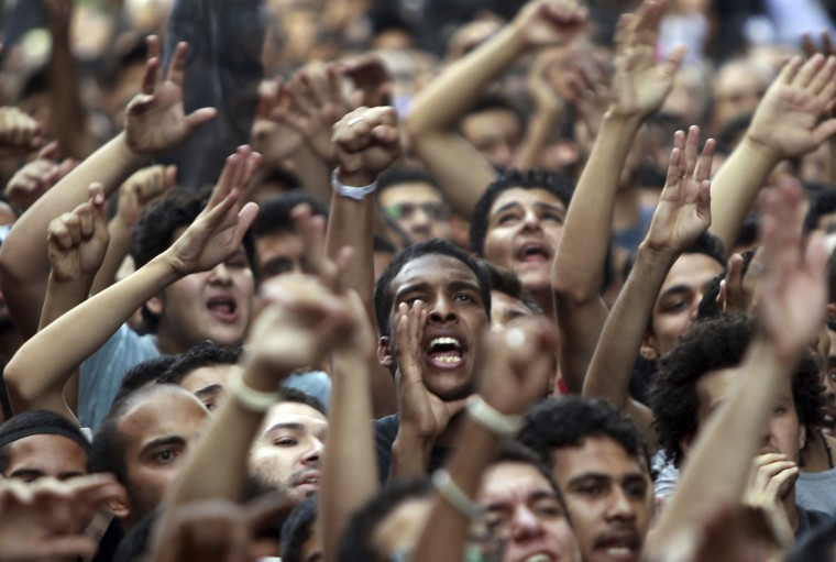 People shout slogans in front of the U.S. embassy during a protest against what they said was a film being produced in the United States that was insulting to the Prophet Mohammad, in Cairo September 11, 2012. (Amr Abdallah Dalsh/Reuters)