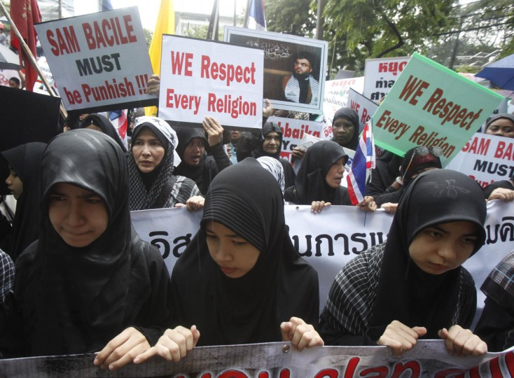 "Muslim demonstrators protest in front of the U.S. embassy in Bangkok. Demonstrators staged a peaceful protest against the anti-Islam film on Tuesday. Around 300 anti-American protesters holding Muslim flags and banners condemned America and chanted ""Allahu Akbar,"" which means God is great. (Chaiwat Subprasom/Reuters)"