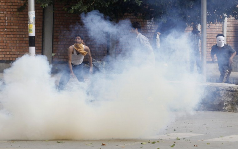 Kashmiri demonstrators throw stones amid tear gas smoke fired by police during an anti-U.S. protest against a film they consider blasphemous to Islam, in Srinagar September 18, 2012. (Danish Ismail/Reuters)