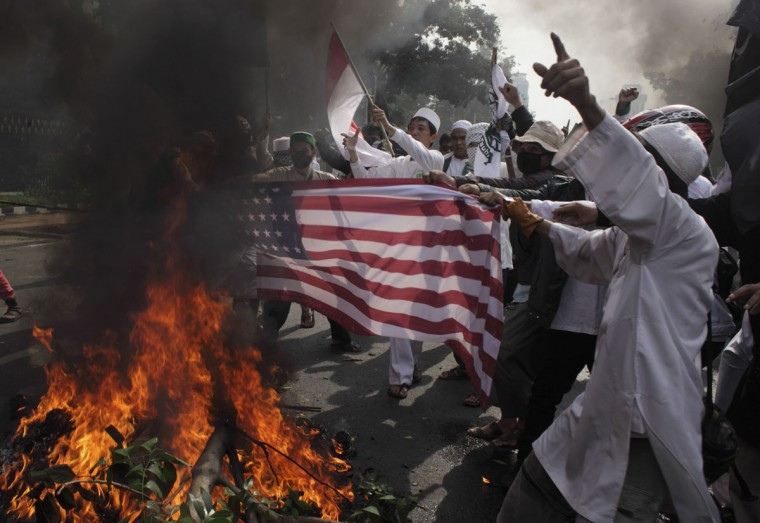 Indonesian Muslim protesters burn a mock U.S. flag during a protest in front of the U.S. embassy in Jakarta September 17, 2012. (Beawiharta/Reuters)