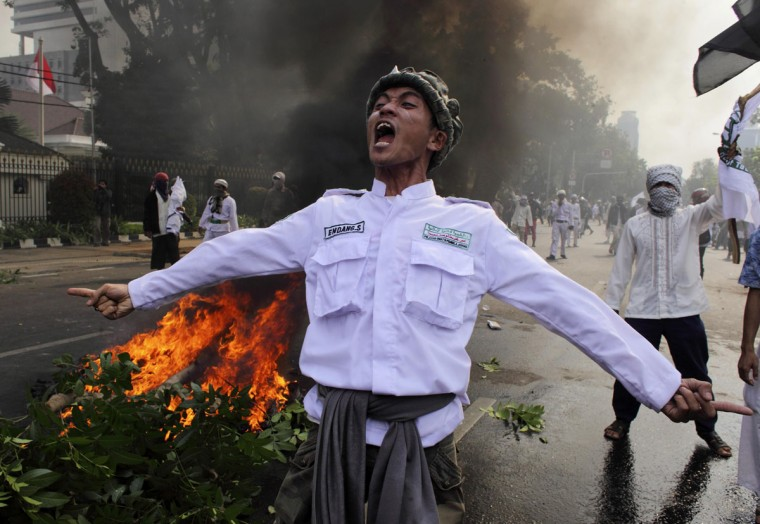 An Indonesian Muslim protester shouts slogans during a protest in front of the U.S. embassy in Jakarta September 17, 2012. Indonesia police used teargas and water cannon on Monday to disperse hundreds of demonstrators who massed outside the U.S. embassy in Jakarta to protest against a film mocking the Prophet Mohammad. (Beawiharta/Reuters)