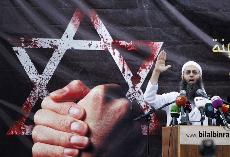 Sunni Muslim Salafist leader Ahmad al-Assir addresses his supporters during a protest, against an anti-Islam film made in the U.S. that mocks the Prophet Mohammad, at Martyrs' square in downtown Beirut. (Mohamed Azakir/Reuters)