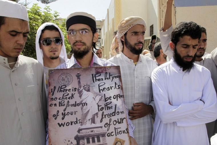 Moroccan Salafists demonstrate against an anti-Islam film made in the U.S. that mocks the Prophet Mohammad outside a mosque in the impoverished Rahma neighbourhood of Sale. (Stringer/Reuters)