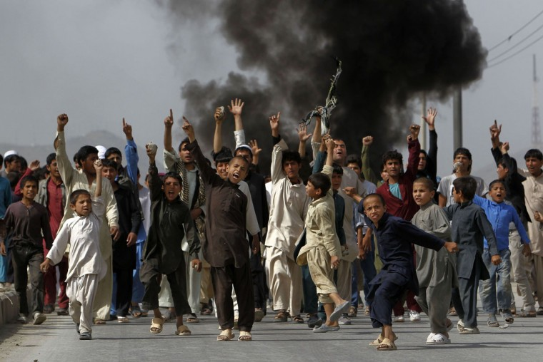 Afghan protesters shout slogans during a demonstration in Kabul September 17, 2012. (Omar Sobhani/Reuters)