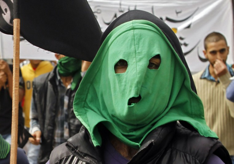 A masked youth attends a strike in Srinagar, September 18, 2012. According to locals, a call for all shops, business establishments, schools, colleges and government offices to be closed and public transport to remain off the roads throughout Kashmir was called on by several local groups. (Fayaz Kabli/Reuters)