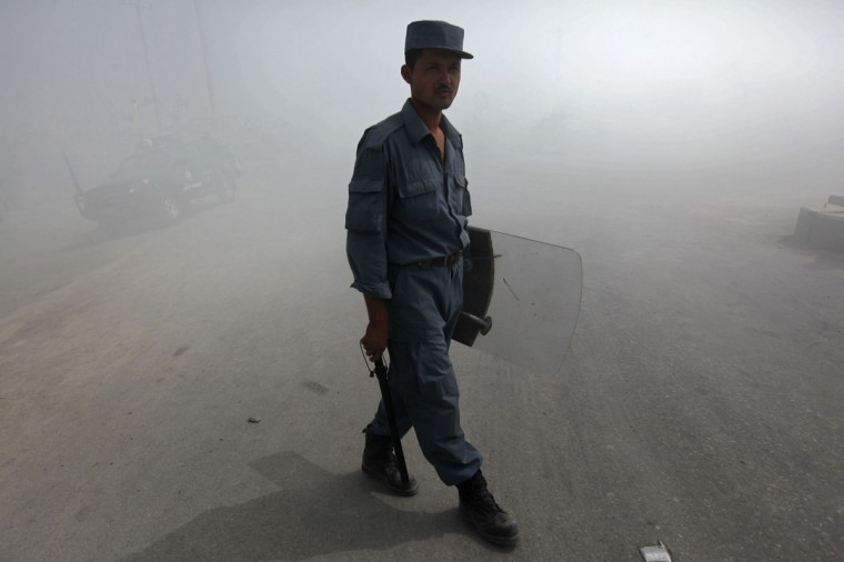 An Afghan policeman keeps watch during a demonstration in Kabul September 17, 2012. (Omar Sobhani/Reuters)