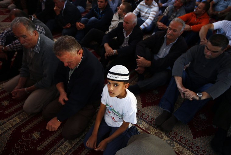 Muslims pray in a mosque before a protest march against an anti-Islam film made in the U.S. and also cartoons published by a French magazine that denigrate the Prophet Mohammad, in Novi Pazar, some 260 km (161 miles) south of the capital Belgrade. (Marko Djurica/Reuters)