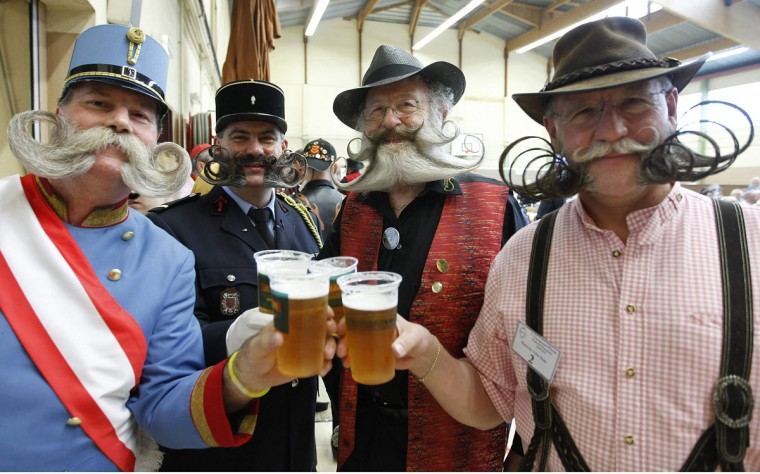 Participants have a beer as they take part in the 2012 European Beard and Moustache Championships in Wittersdorf near Mulhouse, Eastern France, September 22, 2012. More than a hundred participants competed in the first European Beard and Moustache Championships organized in France. (Vincent Kessler/Reuters)