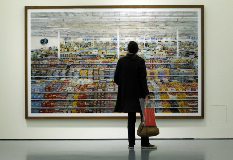 A journalist looks at the artwork '99 Cent' by Andreas Gursky during a media preview of an exhibition at the Museum Kunstpalast in Duesseldorf. The 'Andreas Gursky' exhibition, which features some 60 of works by the German photographer, will open from September 23 until January 13, 2013. (Ina Fassbender/Reuters)