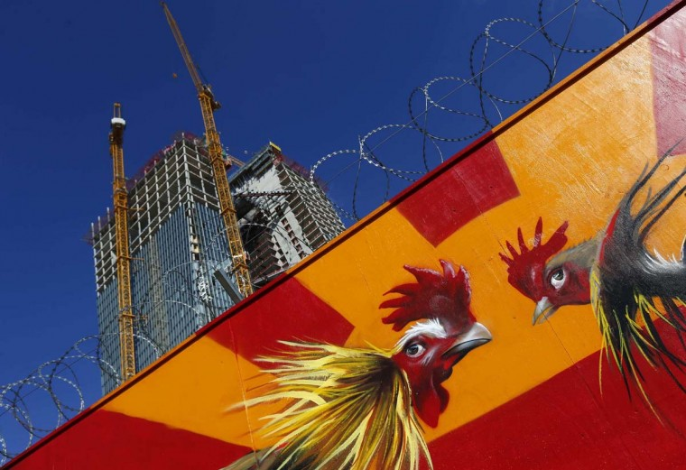 Graffiti of two fighting cocks is pictured on a fence surrounding the construction site of the new headquarters of the European Central Bank (ECB) in Frankfurt. The ECB will hold a topping out ceremony of the new building with ECB President Mario Draghi on Thursday September 20. (Kai Pfaffenbach/Reuters photo)