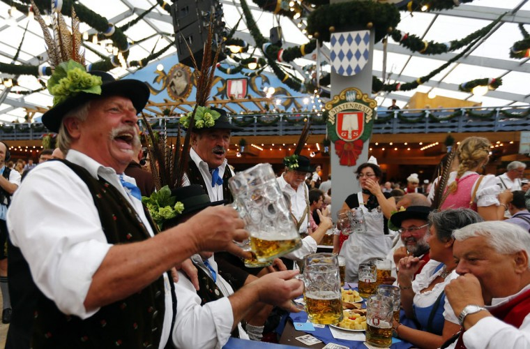 Revelers salute with beer after the opening of the 179th Oktoberfest in Munich, Germany. (Michael Dalder/Reuters)