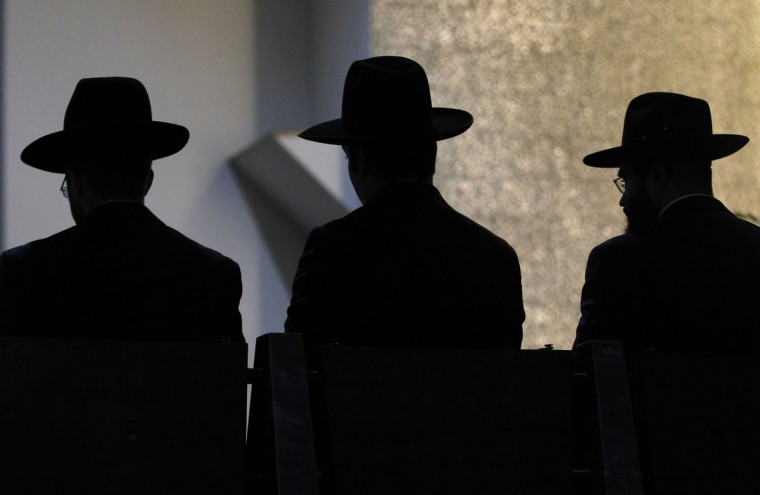 Rabbis are silhouetted as they listen during their ordination ceremony at the Roonstrasse Synagogue in Cologne. The four rabbis who recently completed their studies at the Rabbinerseminar zu Berlin were ordained on Thursday and will serve the German Jewish community. The Rabbinerseminar zu Berlin, also known as Hildesheimer's Rabbinical Seminary, is continuing to contribute to the revival of Jewish life in Germany through the training of young rabbis. (Ina Fassbender/Reuters)