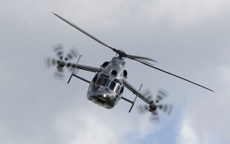 An Eurocopter X3 helicopter is presented during the ILA Berlin Air Show in Selchow near Schoenefeld south of Berlin. Shares in EADS and Britain's BAE Systems tumbled on Thursday as investors feared that a planned tie-up aimed at creating the world's biggest defence and aerospace group could run up against political and regulatory obstacles. (Tobias Schwarz/Reuters)
