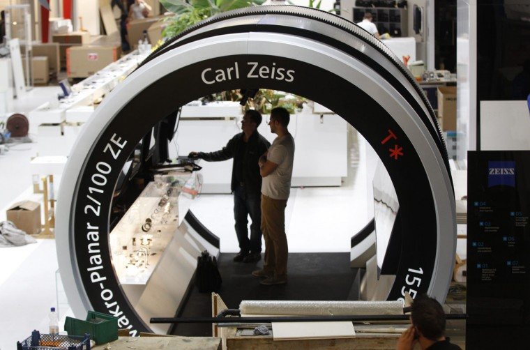 Workers prepare a computer at the stand of Carl Zeiss on the press day of the world's largest fair for imaging in Cologne September 17, 2012. More than 1,200 exhibitors from 45 countries will show their latest products at the Photokina 2012 from September 18-23. (Ina Fassbender/Reuters)