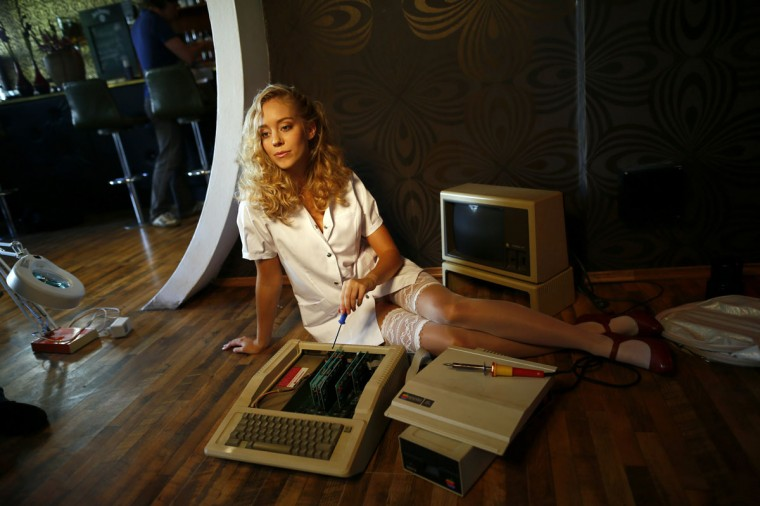 Model Laura poses with a historic computer during a photo shoot for the 'Nerd Dreams Calendar 2013', in Frankfurt September 24, 2012. Harking back to the days of floppy disks, the Nerd Dreams calendar project showcases long-outdated but fondly-remembered computers such as the C64, the Atari ST and Mac SE. The Germany-based team behind this homage to the frontrunners of today's smartphones and tablets PCs are making use of new crowd-funding sites to get financial backing for the project. (Ralph Orlowski/Reuters)