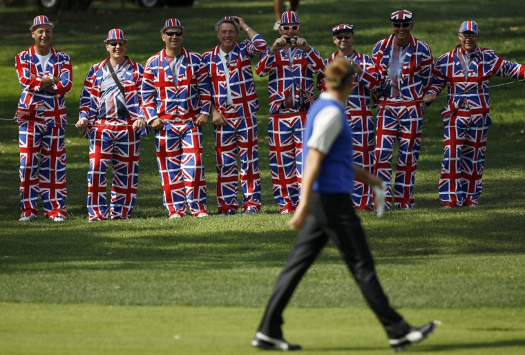 Team Europe golfer Ian Poulter of England walks past a group of specators during a practice round at the 39th Ryder Cup matches at the Medinah Country Club in Medinah, Illinois. (Jeff Haynes/Reuters)