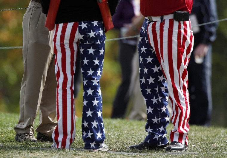 Golf fans wear U.S. flag pants during a practice round at the 39th Ryder Cup golf matches at the Medinah Country Club in Medinah, Illinois. (Jeff Haynes/Reuters)