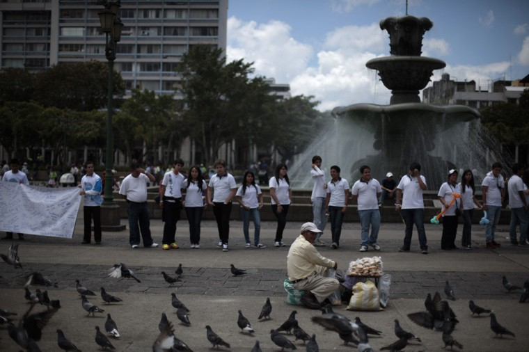 People form a human chain along the streets of downtown Guatemala city to commemorate International Day of Peace in Guatemala City. (Jorge Dan Lopez/Reuters)