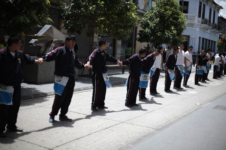 People form a human chain along the streets of downtown Guatemala city to commemorate International Day of Peace in Guatemala City. According local media, youths formed a human chain along the main avenues to the National Palace, calling for peace to remain among Guatemalans and the world. (Jorge Dan Lopez/Reuters)