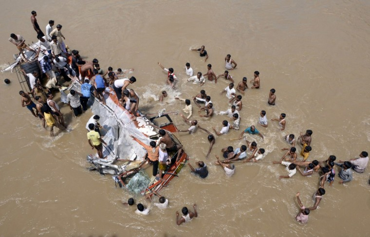 People conduct rescue operations after a bus plunged into the Purna River in Maharashtra's Buldhana district, about 600 km (372 miles) northwest of Mumba. 19 people died when the bus fell into the river and several more were rushed to hospitals nearby, local media reported. (Reuters)