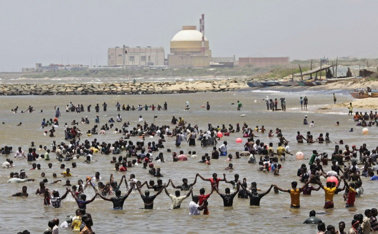 Demonstrators stand in the waters of the Bay of Bengal as they shout slogans during a protest near the Kudankulam nuclear power project, in the southern Indian state of Tamil Nadu. Demonstrators are protesting against the country's largest nuclear power project, over fears about the plant's safety. (Adnan Abidi/Reuters)