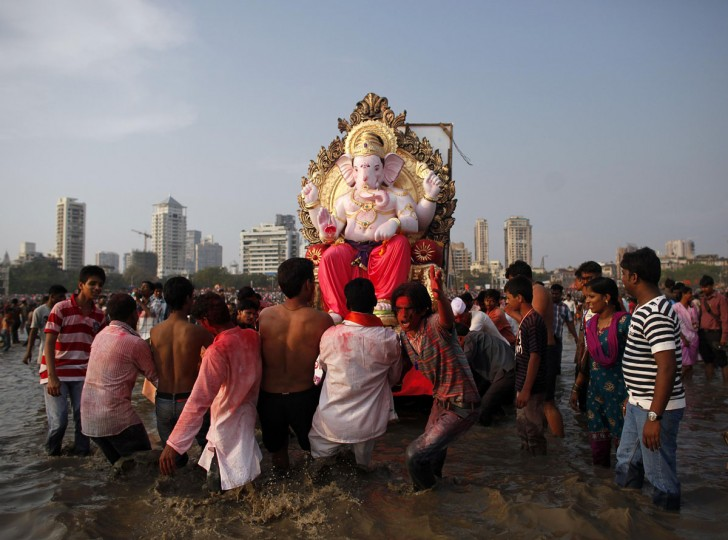 Devotees carry an idol of the Hindu elephant god Ganesh for immersion into the Arabian Sea on the last day of the Ganesh Chaturthi festival in Mumbai. Ganesh idols are taken through the streets in a procession accompanied by dancing and singing and later immersed in a river or the sea symbolizing a ritual seeing-off of his journey towards his abode, taking away with him the misfortunes of all mankind. (Danish Siddiqui/Reuters)