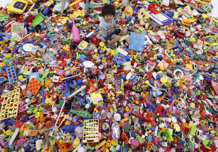 "A boy plays on an artwork made of unwanted toys at the solo exhibition of Japanese artist Hiroshi Fuji, known for his creations that recycle unwanted toys and waste materials, in Tokyo. More than 100,000 unwanted toys collected by social groups across Japan for the past 13 years were used in the exhibition. Called ""Central Kaeru Station - where have all these toys come from? The exhibition runs until Sunday. (Kim Kyung-Hoon/Reuters photo)"