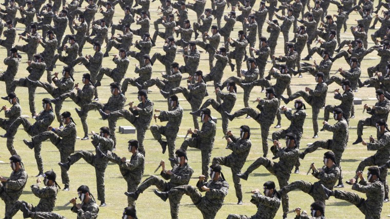 Soldiers of the special warfare command give a demonstration on the eve of the Armed Forces Day anniversary at the Gyeryong military headquarters in Gyeryong, about 140 km (87 miles) south of Seoul, South Korea. (Lee Jae-Won/Reuters)