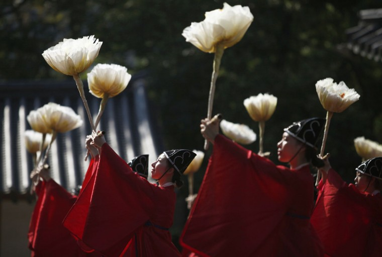 University students majoring in Korean traditional dance wear traditional costumes as they dance during the grand Confucian ceremony of Seokjeon at a shrine at Sungkyunkwan University in Seoul September 24, 2012. Seokjeon is a biannual ritual to consecrate Chinese philosopher Confucius and his disciples as supreme teachers. (Kim Hong-Ji/Reuters)