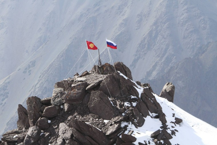 Russian and Kyrgyz national flags fly from 14, 586 feet high on Vladimir Putin Peak in the Tian Shan mountains, some 62 miles south of the Kyrgyz capital Bishkek, September 17, 2012. The peak was named in 2011 in honor of Russian President Vladimir Putin, who is due to visit Kyrgyzstan on Thursday. (Vladimir Pirogov/Reuters)