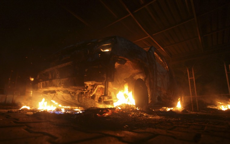 A burning car is seen at the U.S. Consulate in Benghazi during a protest by an armed group said to have been protesting a film being produced in the United States September 11, 2012. (Esam Al-Fetori/Reuters)