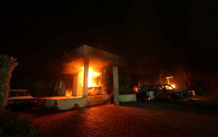 The U.S. Consulate in Benghazi is seen in flames during a protest by an armed group said to have been protesting a film being produced in the United States September 11, 2012. An American staff member of the U.S. consulate in the eastern Libyan city of Benghazi has died following fierce clashes at the compound, Libyan security sources said on Wednesday. (Esam Al-Fetori/Reuters)
