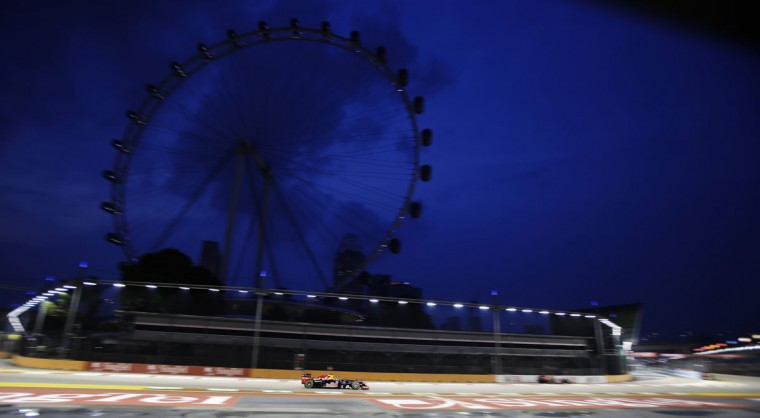 Red Bull Formula One driver Sebastian Vettel of Germany drives during the first practice session of the Singapore F1 Grand Prix at the Marina Bay Street Circuit, as the Singapore Flyer is seen in the background. (Tim Chong/Reuters)
