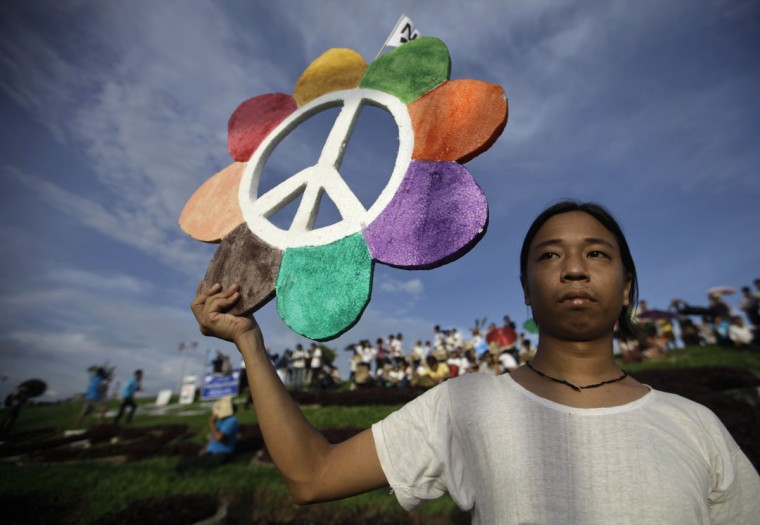 A man holds up a sign during a ceremony to mark the International Day of Peace in Yangon, Myanmar. The Yangon police will press charges against the leaders of the march due to the event being held without official permission, Police Major Myint Htwe said during a news conference. (Soe Zeya Tun/Reuters)