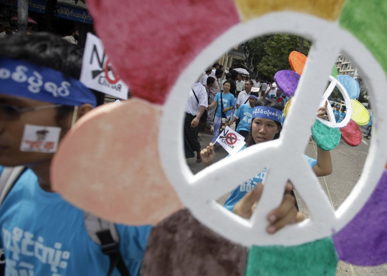 People hold peace signs during a march against civil war to mark the International Day of Peace in Yangon, Myanmar. (Soe Zeya Tun/Reuters)