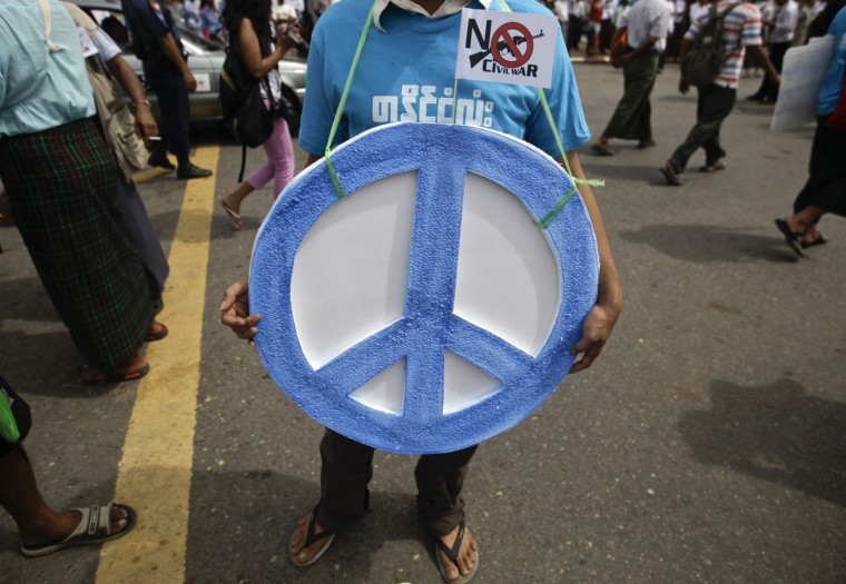 A man hangs the peace sign around his neck during a march against civil war to mark the International Day of Peace in Yangon, Myanmar. Hundreds of people including farmers and ethnic groups participated in the march. (Soe Zeya Tun/Reuters)