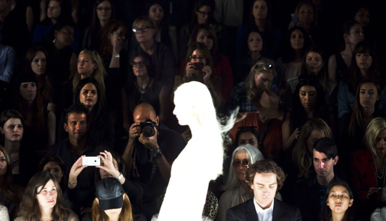 Audience members watch a model during the J. Mendel Spring/Summer 2013 show at New York Fashion Week, September 12, 2012. (Andrew Burton/Reuters photo)
