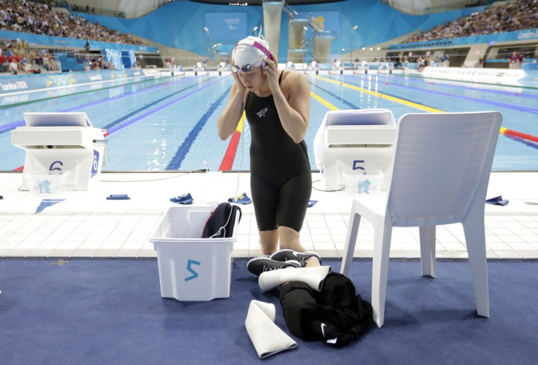 Jessica Long of the U.S. listens to music as she prepares to compete in her Women's S8 50m Freestyle heat at the London 2012 Paralympic games at the Olympic Park in Stratford in London. (Andrew Winning/Reuters)